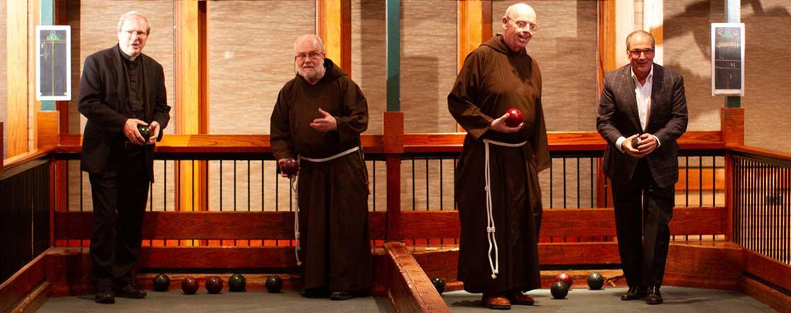 Capuchin friars playing bocce