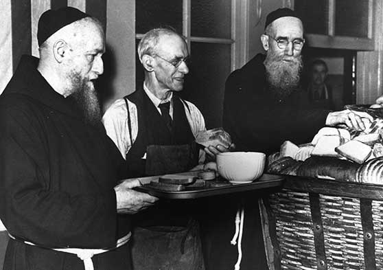 Fr. Solanus along with other friars and volunteers, serving in the Capuchin Soup Kitchen.