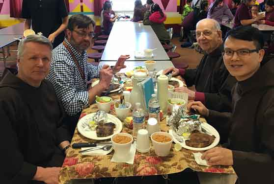 Clockwise from bottom-left: Br. Mark Joseph Costello, Br. Jerry Cornish, Br. Bill Frigo and Br. Tien Dinh sharing a meal